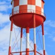 Water tower with red and white stripes - Stock Photo