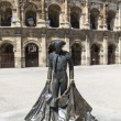 Nimeno II statue and Roman Amphitheater in Nimes, France — Stock Photo #14045524