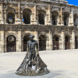 Nimeno II statue and Roman Amphitheater in Nimes, France — Stock Photo #14048155