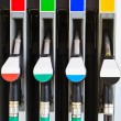 Gasoline pump nozzles at petrol station — Stock Photo