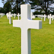 Marble Cross of fallen Soldier, American War Cemetery near Omaha — Stock Photo
