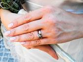 Bride wearing her diamond and wedding rings — Stock Photo