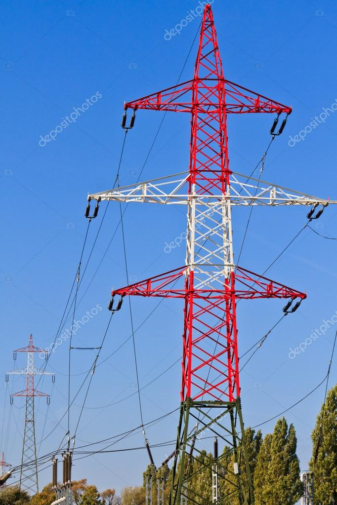 Electrical Tower, Utility Pole, Power Pole before cloudy blue sky — Stock Photo #14600095