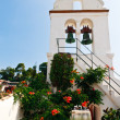 White Church bell tower in Greece (Corfu, Kerkyra) - Stock Photo