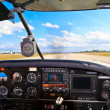 Cockpit view from small aircraft taking off from runway — Stock Photo #14665755