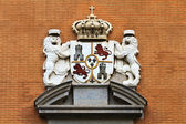 Spanish kings coat of arms on Madrid brick building — Stock Photo