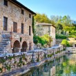 Old thermal baths in the medieval village Bagno Vignoni, Tuscany - Stock Photo