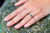 Hand with wedding and diamond engagement rings — Stock Photo