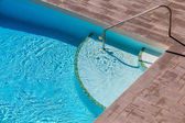 Swimming Pool with wooden floor beside — Stock Photo