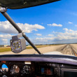 Cockpit view from small aircraft taking off from runway — Stock Photo