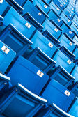 Blue folded seats in a stadium — Stock Photo