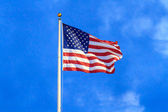 Flag of the United States of America on flag pole — Stock Photo