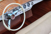 Luxury wooden motor boat - steering wheel and leather seats — Stock Photo