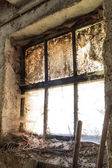 Old window with stains and cobwebs — Stock Photo