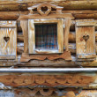 Window with heart shutters of a wooden log cabin in the European — Stock Photo