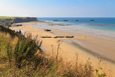 Normandy Landings, remains of artificial port at Arromanches-les — Stock Photo