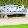 Stock Photo: Ornamental English garden with stone bench