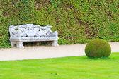 Ornamental English garden with stone bench — Foto Stock