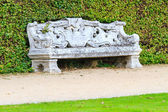 Ornamental English garden with stone bench — Stock Photo