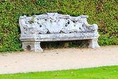 Ornamental English garden with stone bench — Stock Photo