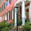 Colonial Brick Architecture with American Flags — Stock Photo #37991927