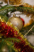 Christmas ornaments on a Christmas tree — Stock Photo