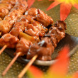 Char-broiled chicken called yakitori - Stock Photo