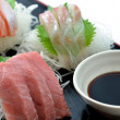 Sliced raw fish called Sashimi — Stock Photo #21854739