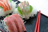 Sliced raw fish called Sashimi — Stock Photo