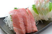 Sliced raw fish called Sashimi — Stock Photo
