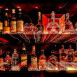 Bottles of spirits and liquor at the bar — Stock Photo #13426160
