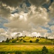 Постер, плакат: Clouds And A Hill Panoramic Version