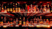 Bottles of spirits and liquor at the bar — Stock Photo