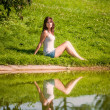 Young woman enjoying the warmth of summer in a park — Stock Photo #15764067