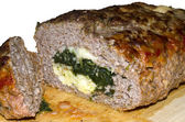 Meatloaf stuffed with spinach, cheese and ham. — Stock Photo