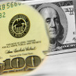 100 dollar bill with a magnifying glass — Stock Photo #13903118