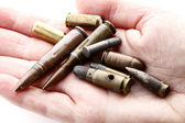 Hand of bullets — Stock Photo