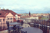 Cafe on the background of the roofs of Prague — Stock Photo