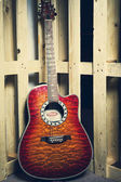 Guitar on a background of wooden planks — 图库照片