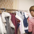 Girl near the wardrobe picks clothes — Stock Photo #45993061