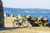 Bicycle stands on the seashore — Stock Photo