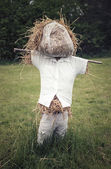 Rustic scarecrow stuffed with straw — Stock Photo