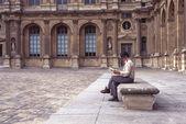 Woman reading a book, Royal Palace, Paris, France — Stock Photo