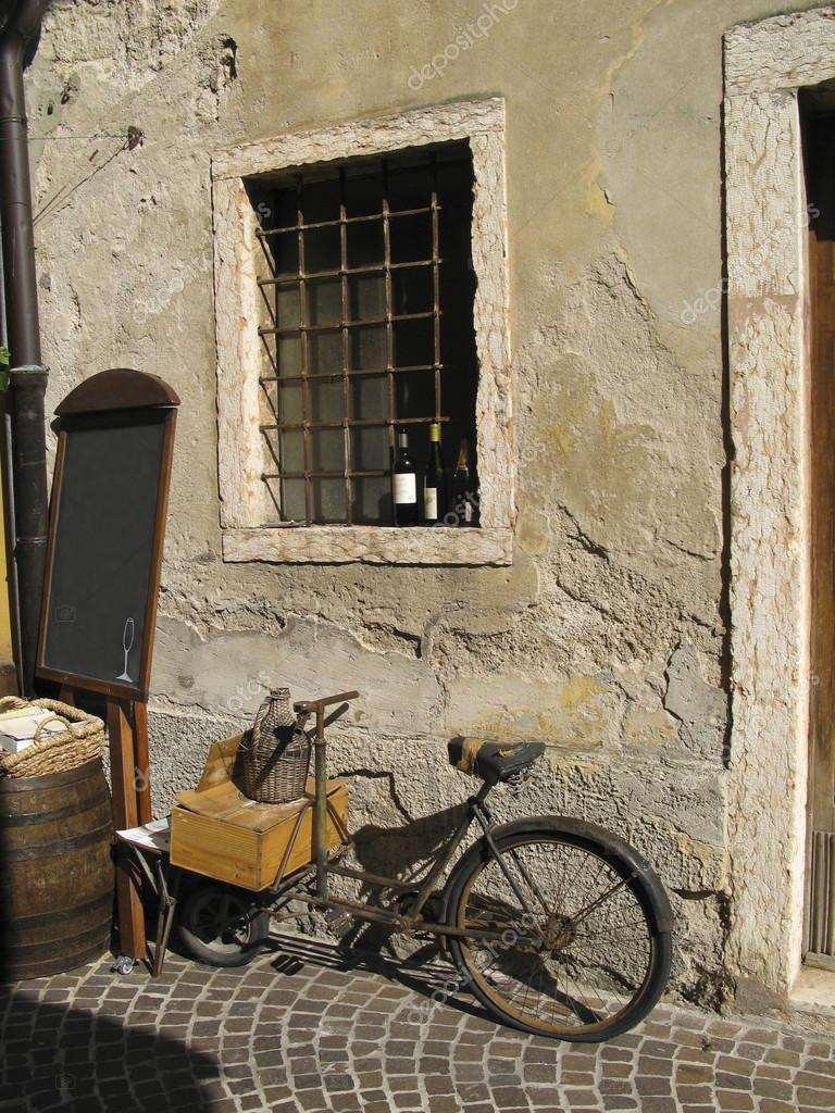Old vintage bicycle on cobble stones against an old wall — Stock Photo #16509511