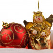 Christmas ball and angel doll — Stock Photo