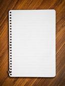Notebook paper on wood floor — Stock Photo