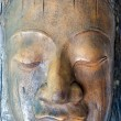 A face sculpted from tree bark — Stock Photo