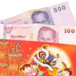 Chinese style envelope with money white isolation — Stock Photo