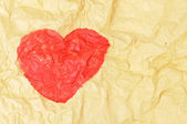 Heart shape on crumpled paper — Stock Photo