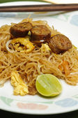 Stir fried noodle Thai style with Thai sausages — Stock Photo